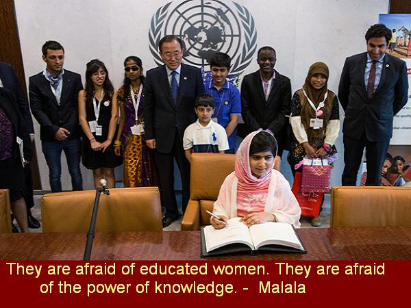 "Malala Yousafzai signs the United Nations guest book while attending United Nations Youth Assembly on July 12, 2013 in New York City. The United Nations declared July 12 ""Malala Day."" Yousafzai also celebrates her birthday today.  (Photo by Andrew Burton/Getty Images)"